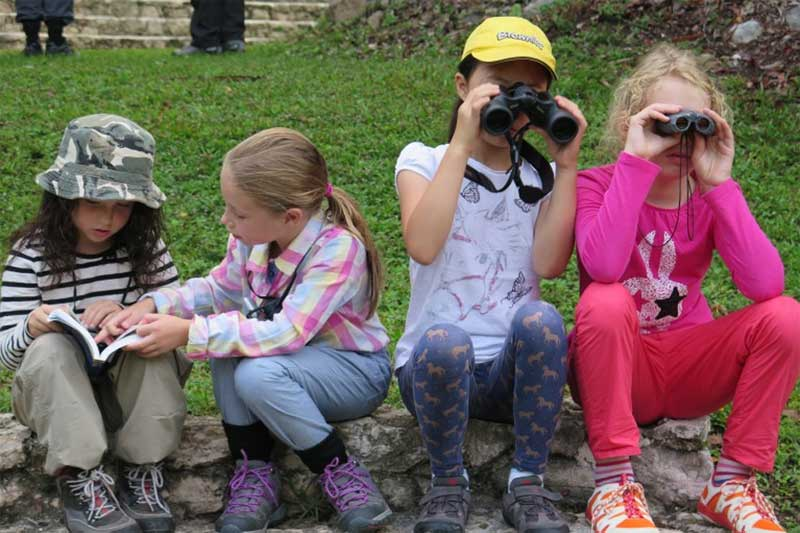 This is what it's all about! Young birders getting to grip with their first bunch of Tanagers
